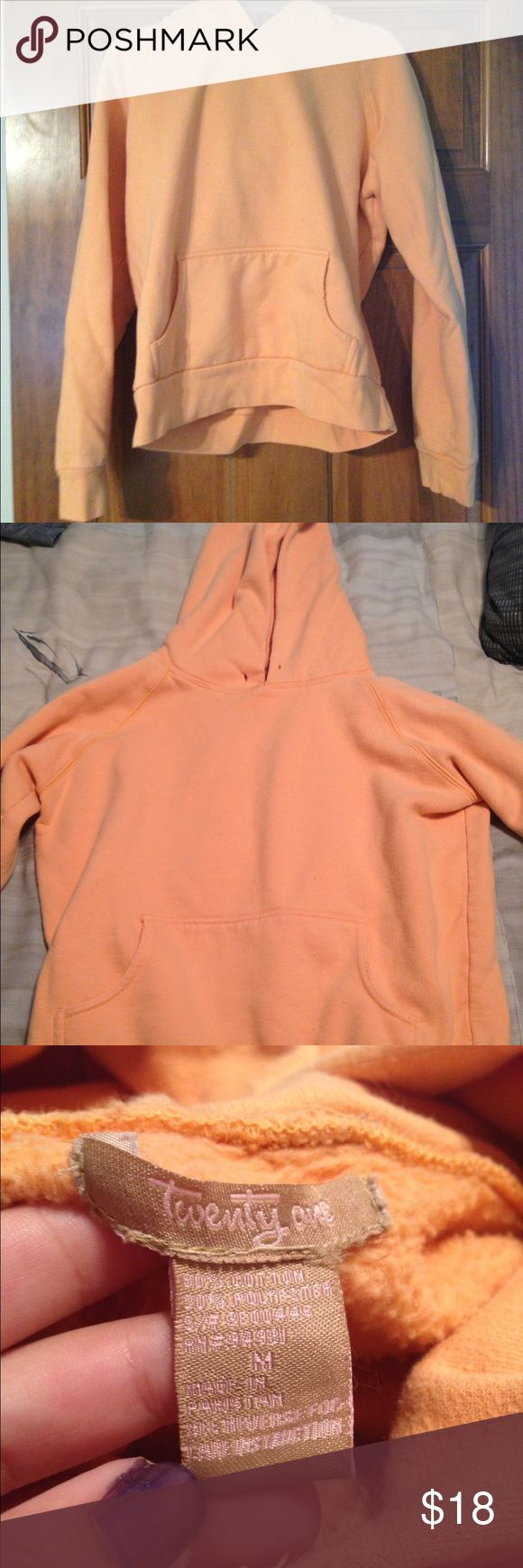 Orange hoodie Orange hoodie with pocket in front. Small hole of hood, not noticeable since it is on the fold. No stains. No strings. Very warm. Girls sz M. Twenty one Tops Sweatshirts & Hoodies