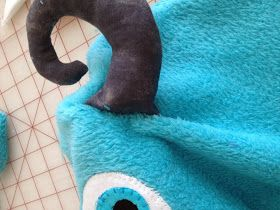 For Halloween 2013, my oldest was Sully from Monsters Inc. The entire costume is home made. I purchased blue fleece and purple fleece on sal...