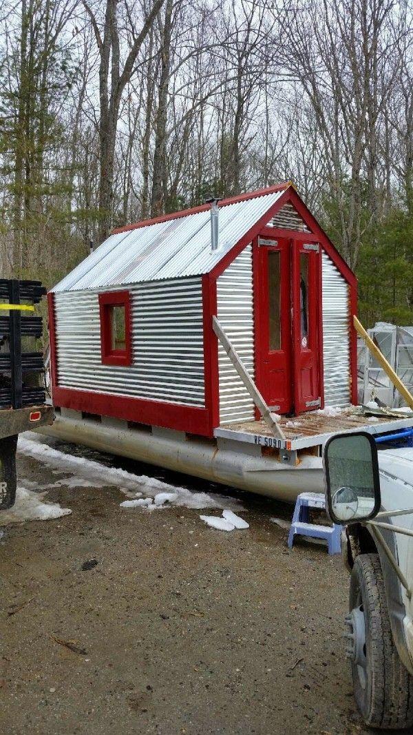 A tin tiny house on pontoon floats.
