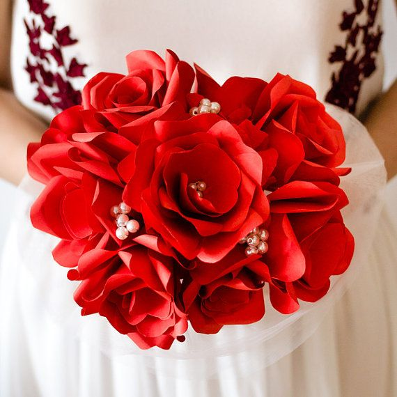 We custom make beautiful bridal bouquets with red paper roses and ivory pearls. Paper flower bouquets are very suitable for religious or civil ceremony. Keep forever the memory of the most beautiful moment of your life!  This bouquet can be done in medium or large size.  Impress! Be unique! Be creative!  We believe we can help you have the most amazing wedding! Call us!  See more at >> www.thediywedding.com