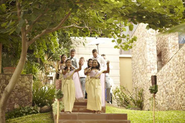 The long drum procession winds it way down the path between the villas - a great and lively start to the day #Farawayweddings #weddingsinthailand #pawanthronluxuryvilla