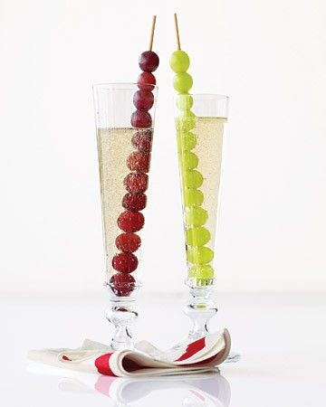 grapes on a stick with sprite or sparkling grape juice in a plastic champagne glass for kids on New Years Eve!