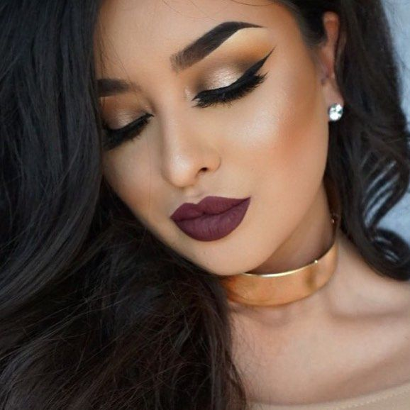 Dramatic winged liner * Burgundy bold lips * Gold broze smokey eye