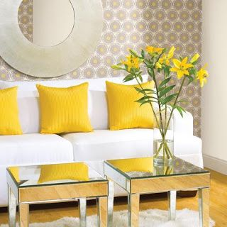 Yellow is a happy communicative colour, full of life. Used as an accent colour in this room with white it looks light and fresh. The grey adds a modern depth and the mirrored tables add a touch of elegance. The wallpaper is a much needed pattern in the scheme. Tip- When using yellow in living areas team it with metallics, grey and glass to achieve a mature and elegant style.