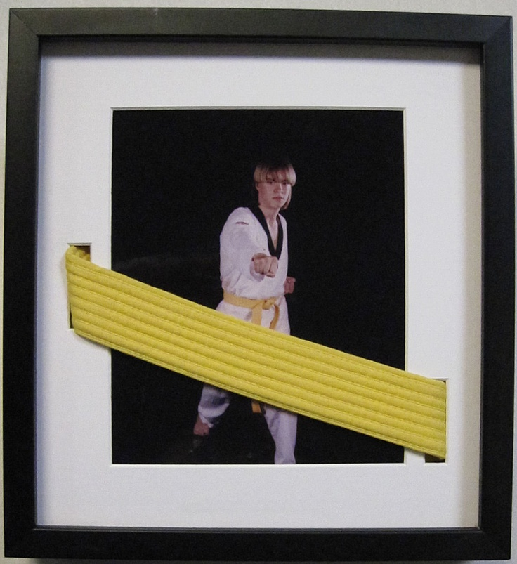 We've never seen a Karate belt incorporated into a custom frame quite like this before... Very clever! Kudos to the custom framer who thought outside of the box - or, in the case the mat - to create this amazing memory!