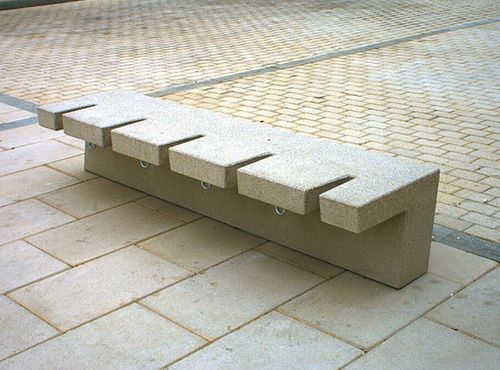 Concrete bench / bike rack / skateboard proof - line street to protect pedestrian when street is used for cars