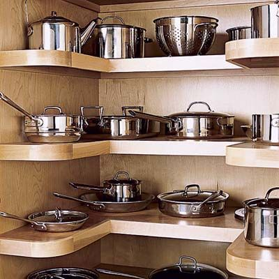 A pantry devoted to pots and pans keeps them out of sight but readily accessible. U-shaped plywood shelves put the whole contents on view; rounded edges make scrapes less likely. | Photo: David Prince | thisoldhouse.com