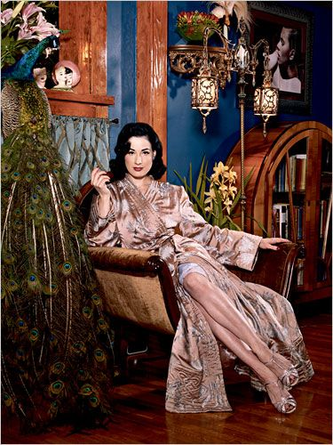 Dita von Teese lounging at home in her vintage dressing gown.