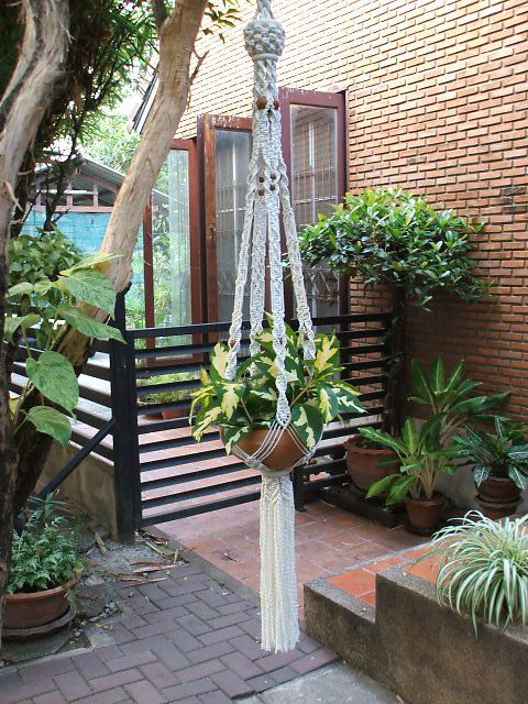 """Wonderful design of Macramé Plant Hanger in traditional style Persia, perfect for 9-11"""" (diameter) plant pot. The hanger is made of white bleached poly cotton (cotton + polyester) twisted cord and wooden beads. Plant pot not included. Size: 65""""(165 cm) overall length (top of the hanger to end of its tassel) We also have natural white (unbleached) poly cotton for your choice, just let me know whenever you order. Please note the item is made to order therefore it will be shipped within 7-10..."""