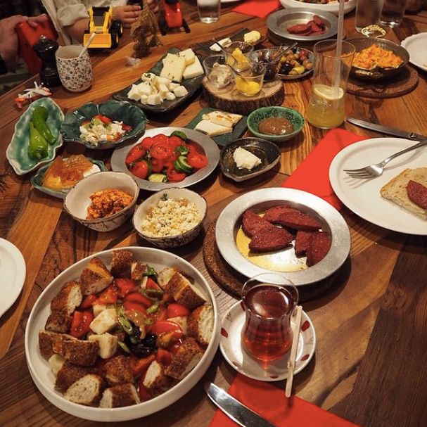 An appetizing shot from a modern style of traditional dishes of Turkish breakfast with a cup of tea, an essential part of Turkish culture...