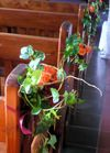 Flowers displayed at each Church Pew by Kent Florist Mikiko Inoue