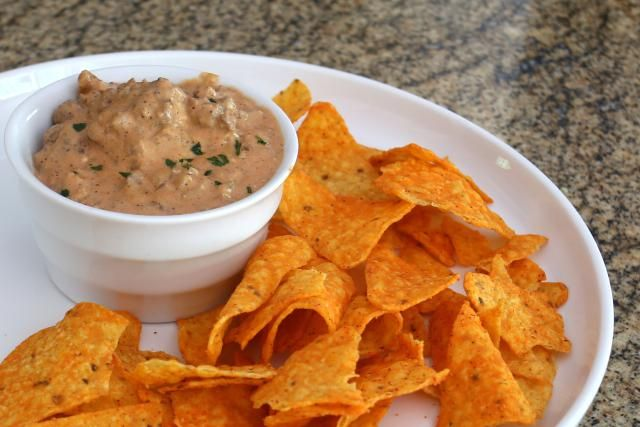 This crockpot hamburger dip is made with cream cheese, ground beef, and onion and garlic. Serve this dip from the crockpot with tortilla chips.