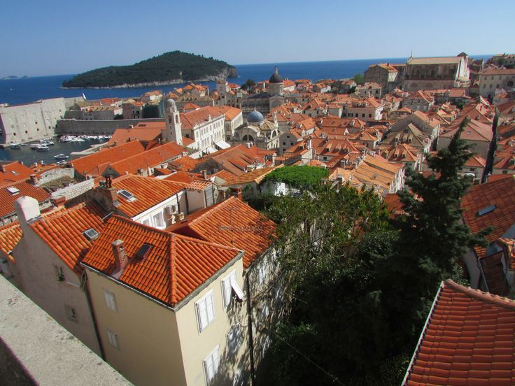 Beautiful terracotta roofs against the blue of the Adriatic Sea - view from walled city Dubrovnik