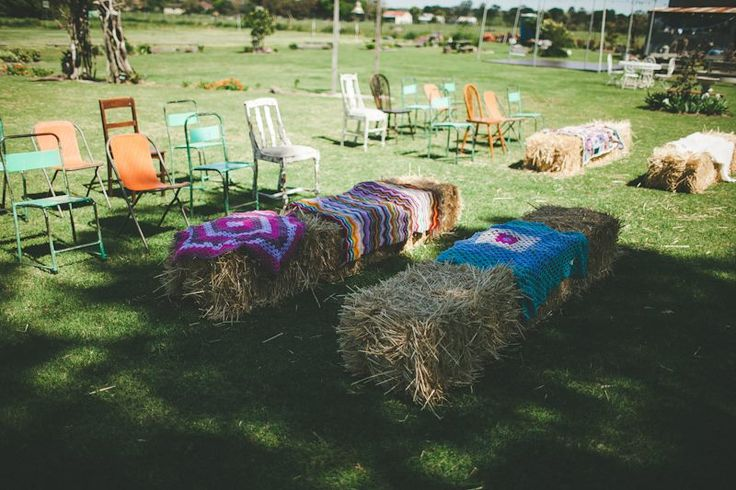Straw hale with throws are the perfect seating option for a country/vinatge wedding #ivyandmoss #strawhales #seating #wedding #vintage #eventstyling