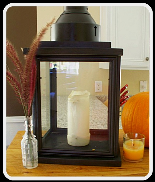 "lantern from dollar store frames - use three (various sizes) and use cricut to ""etch"" wording to match sconces - will set on buffet"