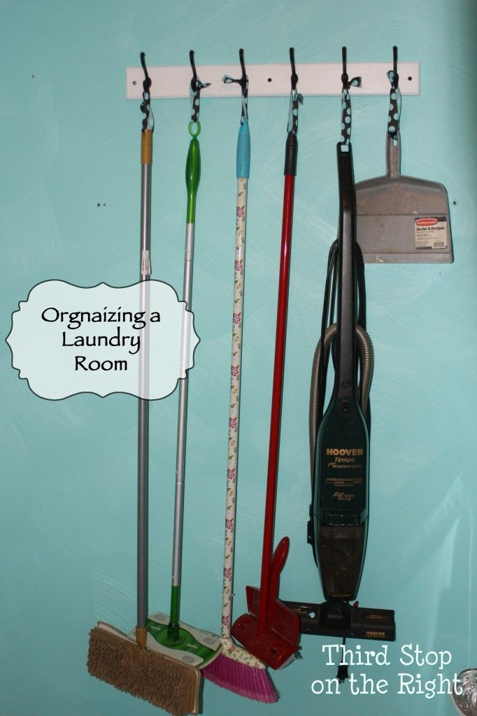 A great way to organize mops and brooms in a laundry room. Best part is that it doesn't take a lot of space!