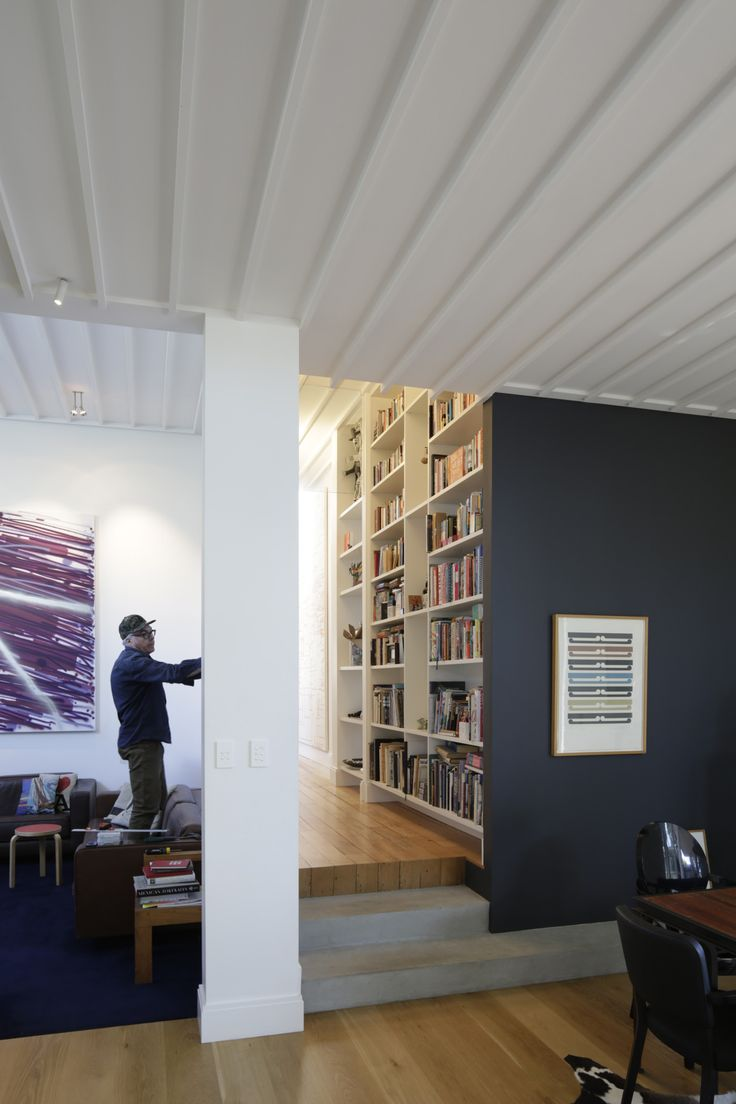 John Reynolds hangs artworks in his Auckland home, recently renovated by architect Malcolm Walker. The artwork at left is by John Reynolds, while the print at right is by Gordon Walters. Photograph by Patrick Reynolds.