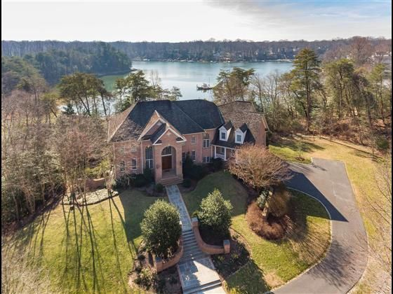 This magnificent estate home is nestled on 1.7 acres of Severn River waterfront behind the gates of The Bluffs in Severna Park Maryland.This home on caters to both every day living and upscale entertaining while the protected deep water cover with private pier with boat and jet ski lifts and private beach provides many hours of outdoor fun and relaxationThe stately brick and slate entry leads to the grand foyer. Incredible coffered ceiling highlights the great room with palladium windows…