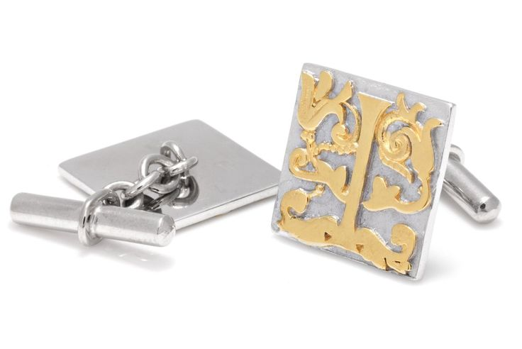 Sterling silver cuff links with raised gold plate detail. £475