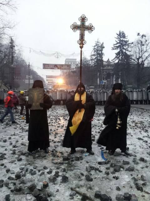 Orthodox Priests Standing between Protesters and Police in Ukraine