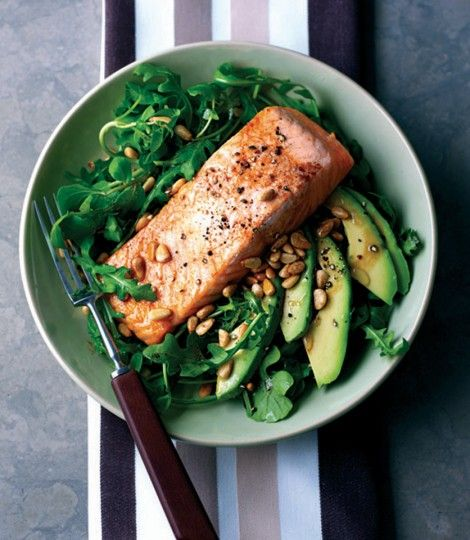 A quick and easy grilled salmon recipe has real flavour of the Mediterranean, served with avocado and pine nuts.