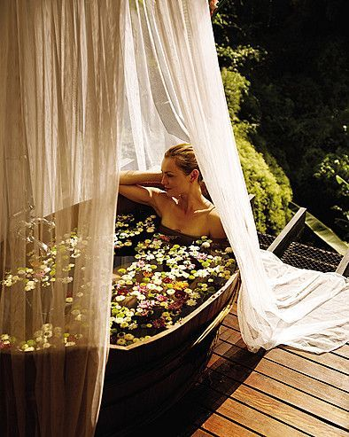 This outdoor bath strewn with flower petals is so pretty and such an indulgent treat