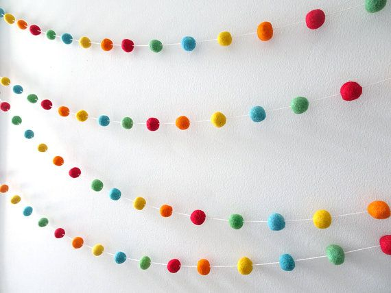 Colorful rainbow wool felt garland that would brighten up a birthday party, baby nursery, baby shower or room.  Suits circus theme and carnival theme parties and room decor.  Felt ball garlands are a very versatile, reusable decoration, that can be hung nearly anywhere in your home. Against a plain wall, over a mirror, desk, crib! The list is endless. It would also make a great gift.   Details (as shown in photo):  • 23mm (approx 1 inch) 100% wool felt ball. Please note that every ball is…