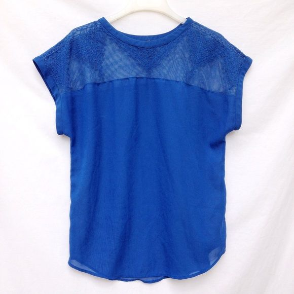 Cobalt Blue Short Sleeve Top Size 6, cobalt blue top. Has a lace or crotchet like design by top area, and is a flowy, thick chiffon like fabric. H&M Tops Tees - Short Sleeve