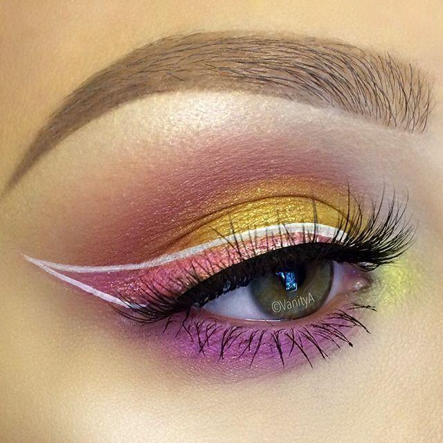 colorful #pink + yellow light #eye #makeup @vanitya + white outlined winged eyeliner