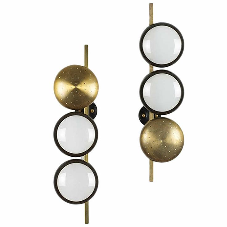 Pair of wall lights by Oscar Torlasco | From a unique collection of antique and modern wall lights and sconces at http://www.1stdibs.com/lighting/sconces-wall-lights/