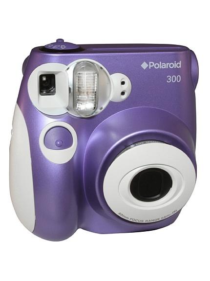 """fotocamera istantanea analogica, formato stampa 2,1"""" x 3,4"""". Flash automatico. Zoom ottico 3x."""