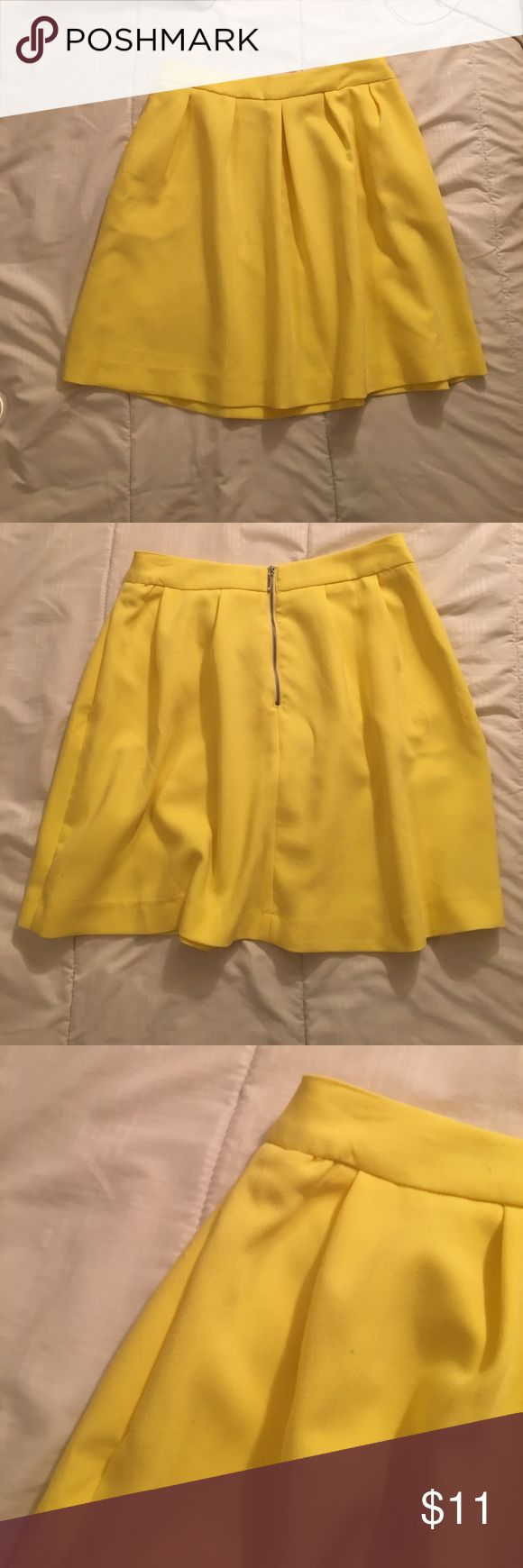 Yellow skirt Yellow skirt perfect for the summer. 33 cm waist size. 44 cm length. Worn one time. Perfect condition other than the tiny blue mark shown on the last picture above. stradivarius Skirts Mini