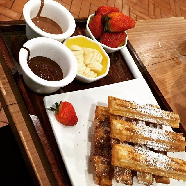 The perfect dessert - churros with strawberries and banana, all ready to be dipped in either milk chic or dark choc sauce! Photo by @vivifean #oliverbrown