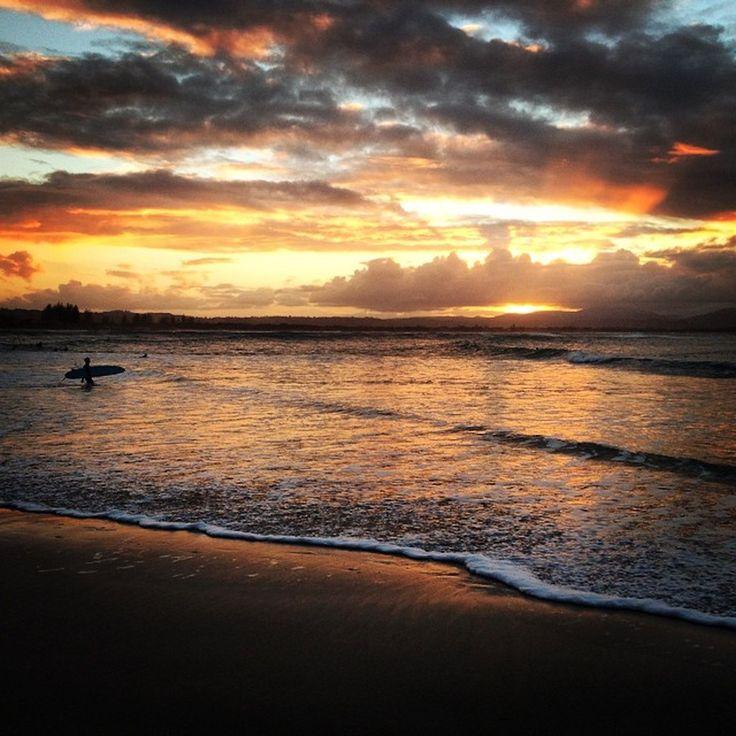 Surfer and sunset at Clarkes Beach. Instagram: Byronbayyogi
