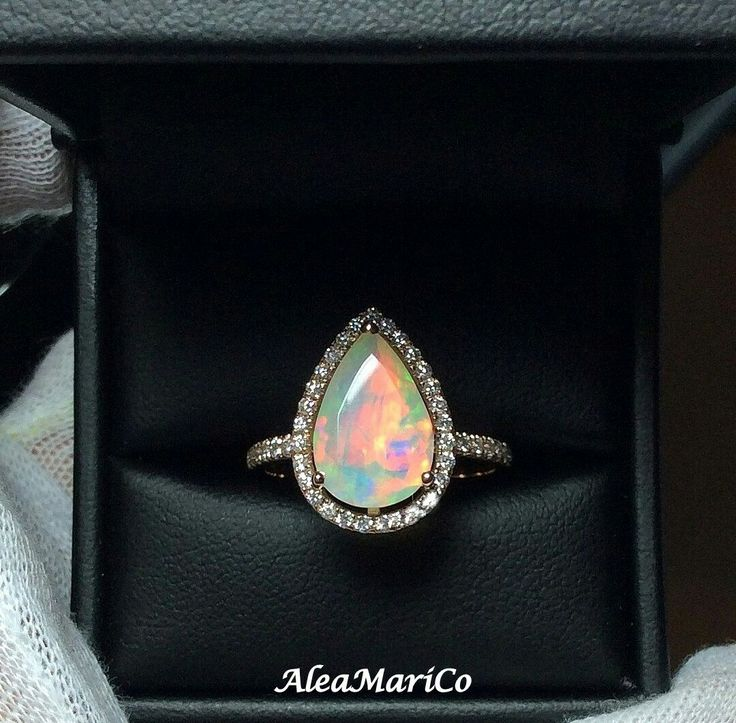 Ethiopian Opal and Full Cut Diamond Ring. We specialize in all Custom Engagement Rings,  and Fine Jewelry at Alea Mari & Co.. @aleamarico,  Etsy