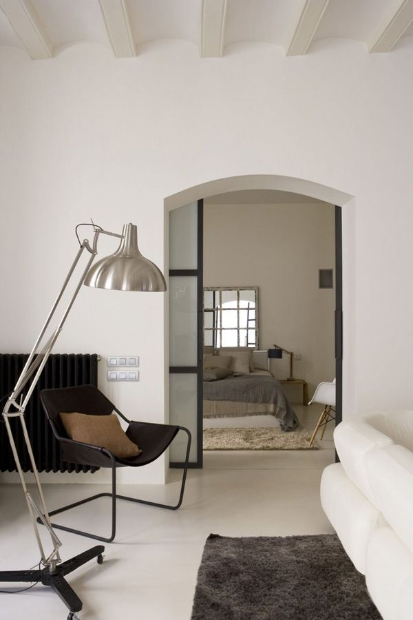 living area with view to bedroom {and glass sliding door}. Apartment in Barcelona's Gothic Quarter.