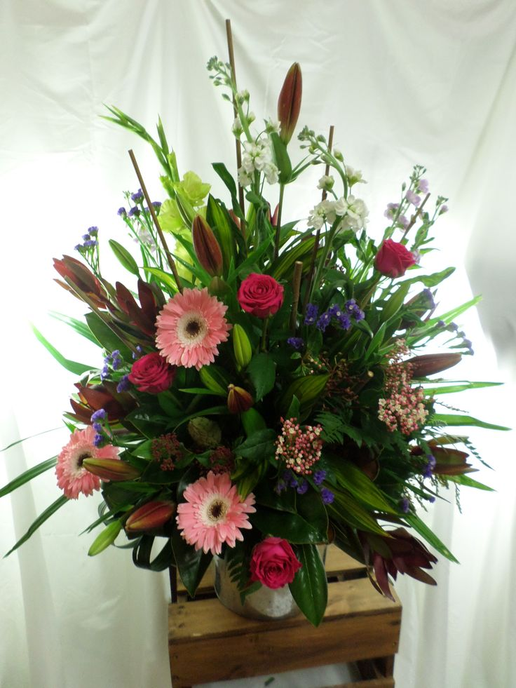 Large table arrangement. Wild mix of flowers. Created by Florist ilene