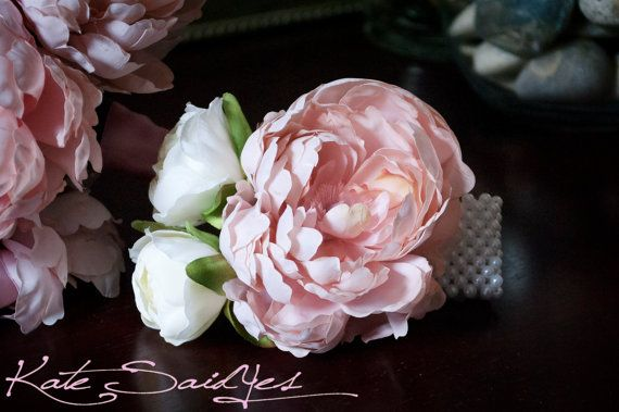 Wedding Corsage - Pink Peony Wristlet Corsage Soft light pink peony accented with a creamy ranunculus blooms on a pearl wristlet