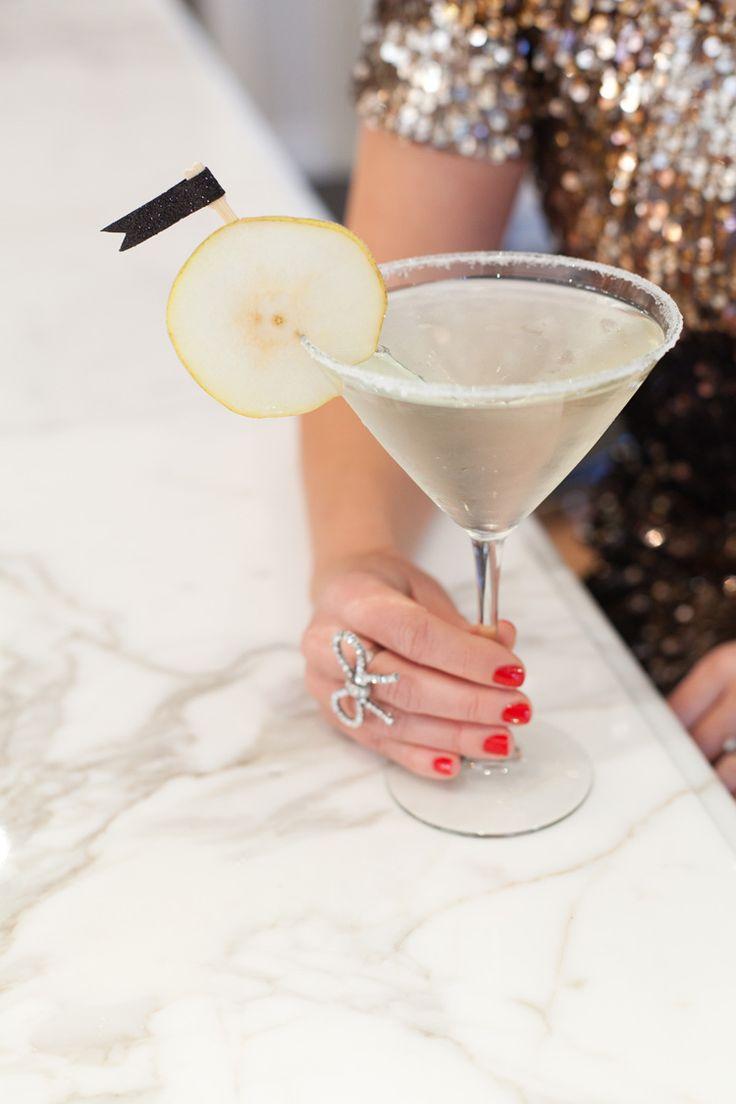 French Pear Martini: 1 ½ oz. St. Germain Elderflower liqueur, 1 ½ oz. Pear Vodka, Chilled Champagne, Granulated sugar for the rim, 1 lemon, wedged, 1 pear, sliced