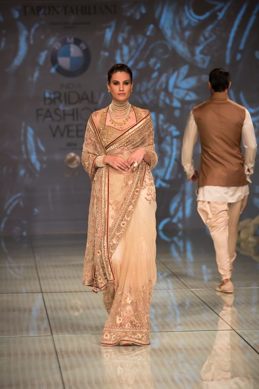 Tarun Tahiliani gold mother of the bride or groom sari. More here: http://www.indianweddingsite.com/bmw-india-bridal-fashion-week-ibfw-2014-tarun-tahiliani-show/
