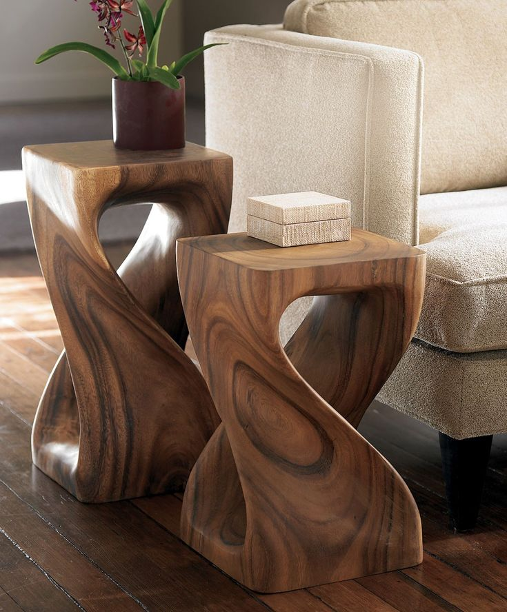 The soft curves of these carved wood tables make them a natural for the bedroom. Use as nightstands or vanity seating. #aclearplace
