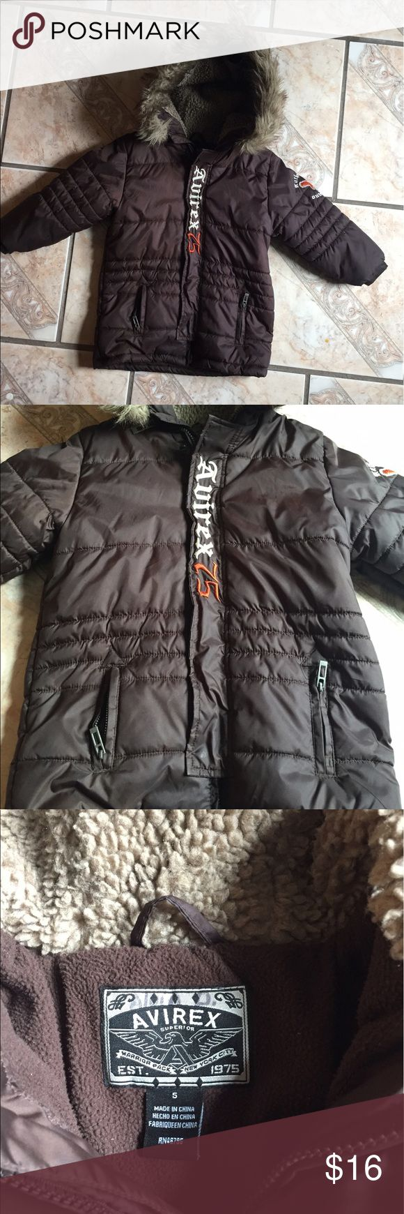 Brown Winter Puffer Jacket This jacket will be perfect to shelter your little love one from the cold winter temps. Has fur around the hood and can be securely closed with zipper and buttons with zipper to close the pockets. Excellent buy before the cold season comes in! Jackets & Coats Puffers