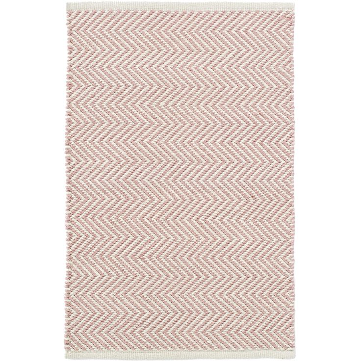 Youll love this peppy pale pink and ivory, zigzag indoor/outdoor rug! Made of thick, eco-friendly PET, this area rug is not only adorable, but also durable and easy to clean--the perfect addition to the kitchen, bathroom, kids room, or outdoor areas.Made of 100% PET, a polyester fiber made from recycled plastic bottles.In order to achieve its rustic charm, this rug has been woven with large-diameter yarns. Consequently, slubs, knots, and other imperfections inherent to the hand-weaving…