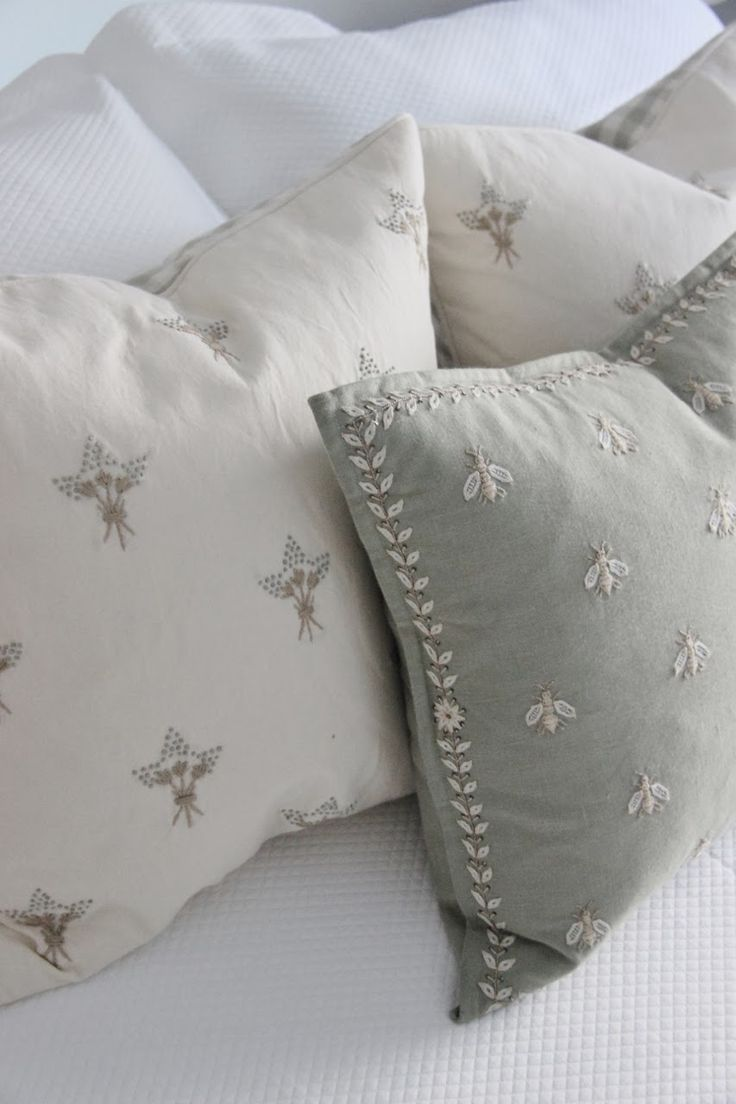 Beautiful Grey and White FRENCH linen bed pillows with embroidered bumblebees and flowers.  Simply Beautiful Home Design.  Grey Bedding.
