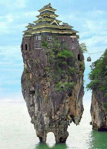 Where does the house end and the rock begin | Also there is a cable car going to it.