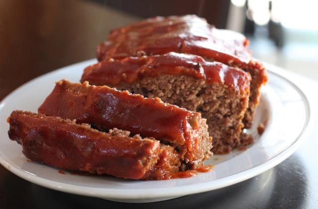 This top rated easy meatloaf will become a family favorite. This is a simple basic meatloaf made with 2 pounds of ground beef, milk, eggs, and minced onion, along with seasoning and a little ketchup.