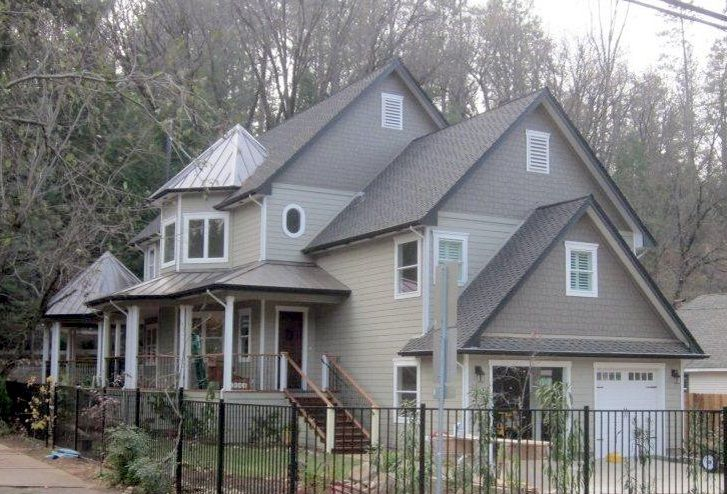 Composition Roofing with metal roofing accents.