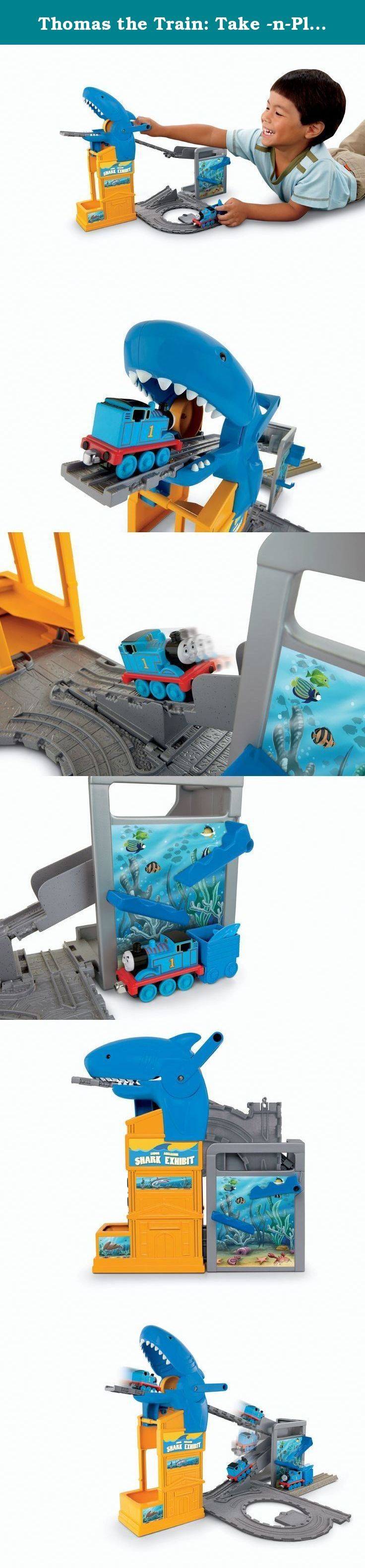 """Thomas the Train: Take -n-Play Shark Exhibit. Fast-Paced Fun in a Daring Adventure Thomas' Shark Exhibit is a Take-n-Play portable fold-out railway playset that combines the fun of train play with kids' fascination with sharks. Steer the die-cast metal Thomas through the exhibit entryway. As Thomas enters the exhibit he is sent rolling down the tracks. As he passes by Thomas activates the """"shark drop"""" which releases the creature from its holding tank and into Thomas' cargo car. From there..."""