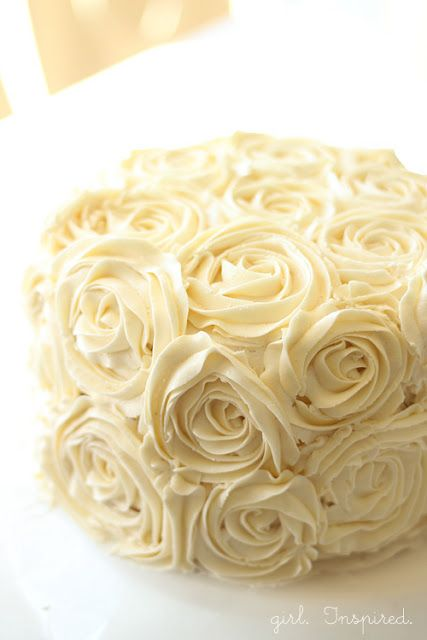 Tips for Making a Swirled Rose Cake - Girl. Inspired. make circular imprints on cake with a small cookie/biscuit cutter
