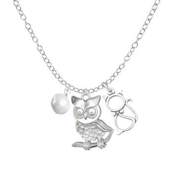 A beautifully delicate sterling silver chain with an elegant sterling silver owl charm paired with a pretty cat. A white freshwater pearl completes the sea theme.